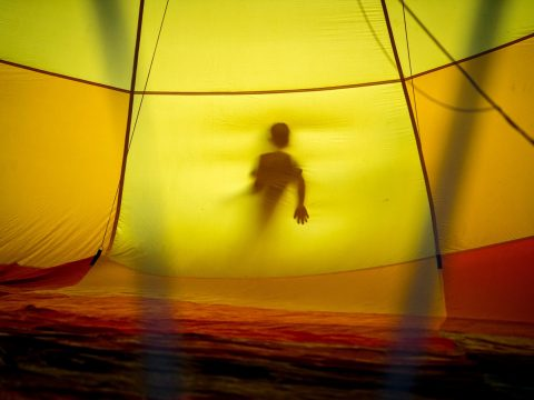 person in tent