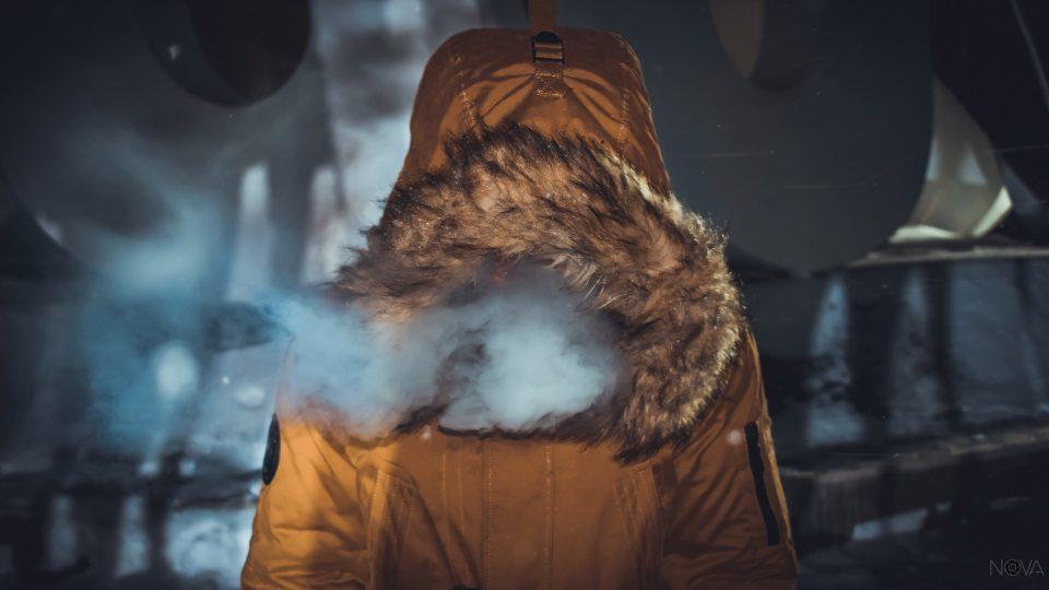 person in parka cold