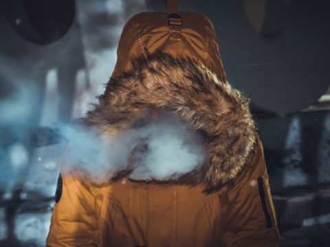 person in parka cold