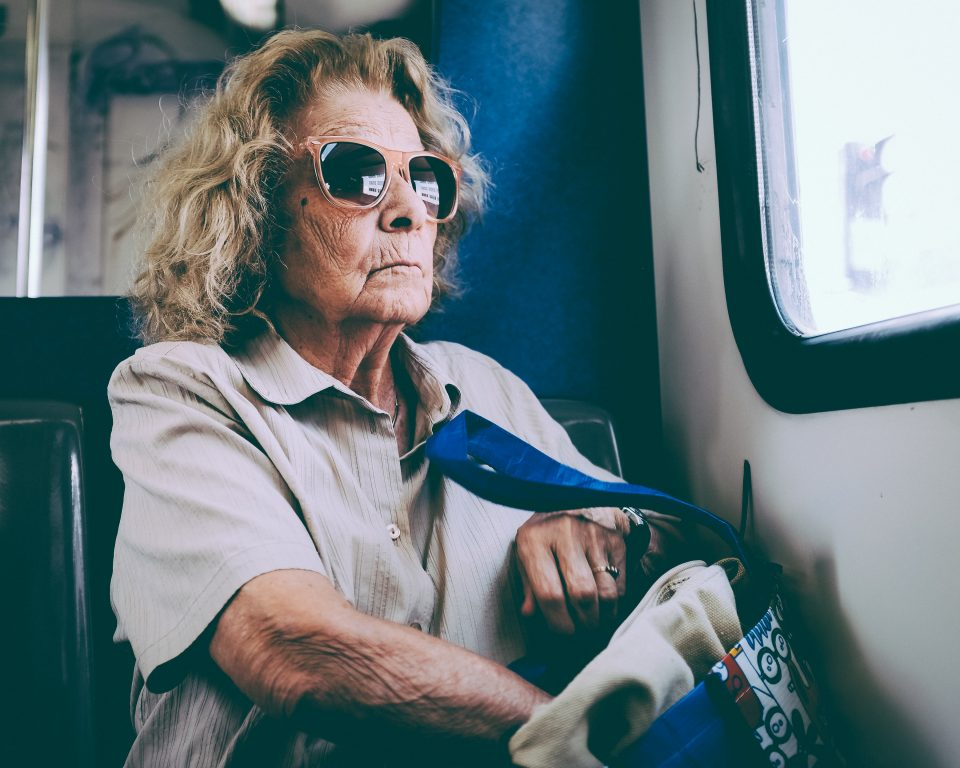 older woman with bag