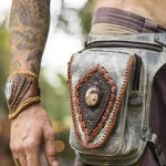 man wearing burning man festival belt