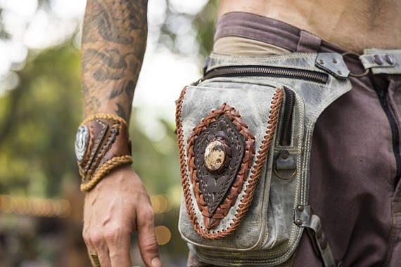 man wearing burning man festival belt
